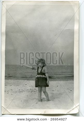 Vintage unretouched photo of young girl on beach