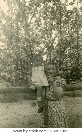 Vintage photo of mother and baby son (forties)