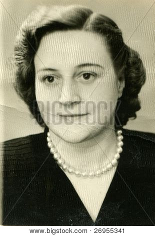 Vintage unretouched portrait of young woman (forties)