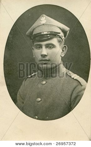 Vintage photo of man in military uniform (twenties)