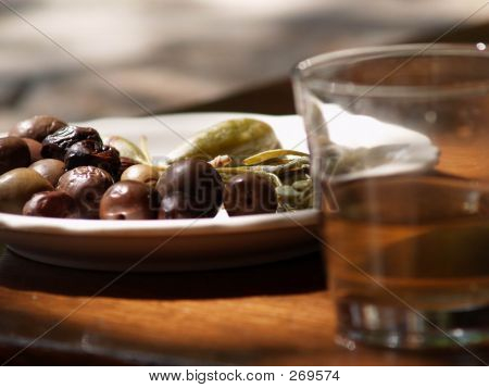 Olives And The Glass Of Wine