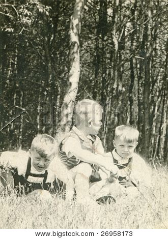 Vintage photo of brothers playing outdoor (fifties)