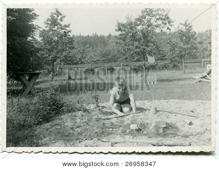 Vintage photo of boy playing outdoor  (fifties)