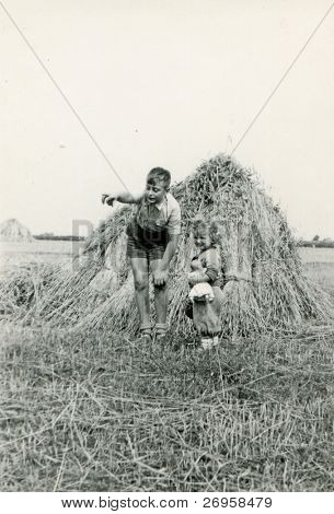 Vintage photo of brother and sister (fifties)