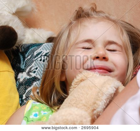 Face Of Little Blond Girl Laughing, Close-Up