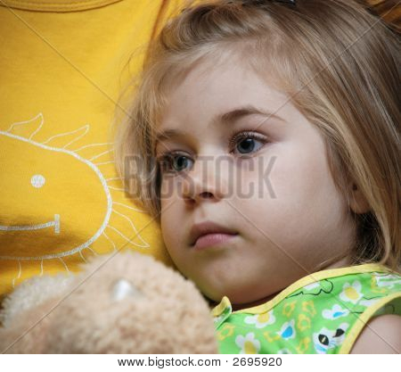 Calm Face Of Little Blond Girl, Close-Up