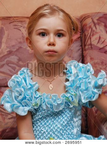 Afraid Face Of Little Blond Girl With Wide-Open Eyes