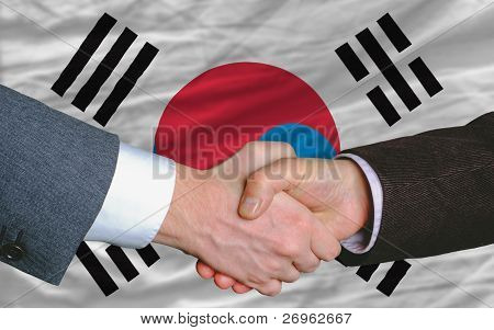Businessmen Handshake After Good Deal In Front Of South Korea Flag