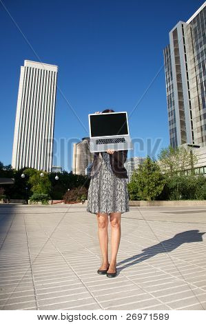Businesswoman Opening Laptop In Madrid City