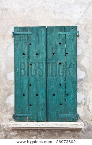 Grungy old green wooden window