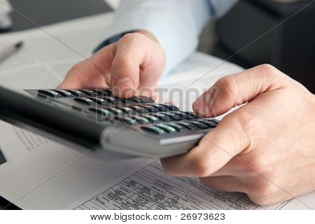 Businessman holding a calculator