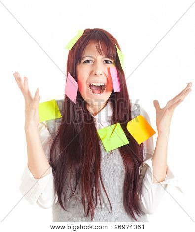 Businesswoman getting mad covered with sticky notes