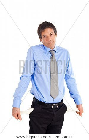 Poor businessman turns out his empty pockets isolated on white