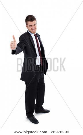 Young businessman isolated on white, full length and showing thumbs up