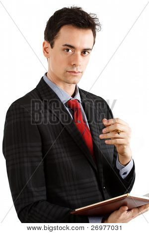 Portrait of a young successful businessman holding a pen. Isolated on white.