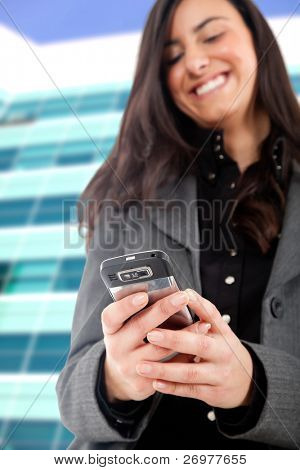 Young woman receiving a pleasant sms