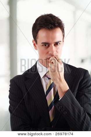 Businessman holding a grudge against someone.