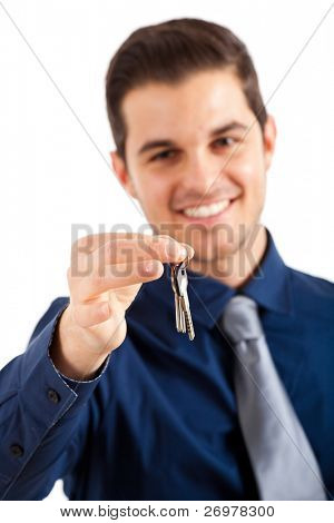 Businessman giving you the keys