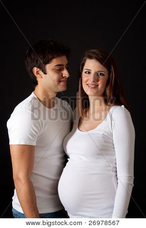 Happy couple on a dark background