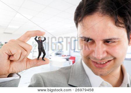 Big businessman crushing a small one