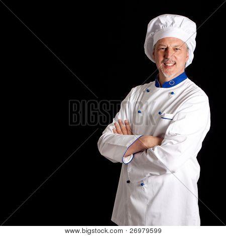 Portrait of an handsome chef. Dark copyspace.