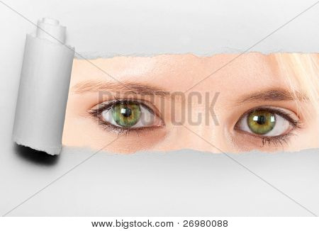 Ripped paper showing green woman's eyes