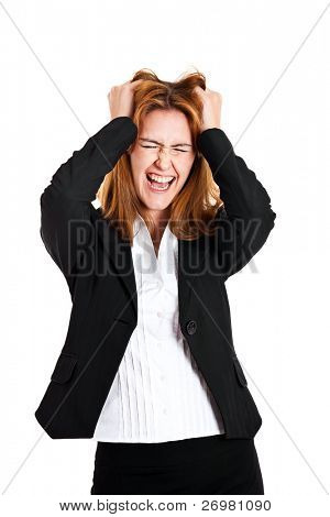 Portrait of a desperate young businesswoman pulling her hair