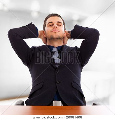 Young businessman relaxing in his office