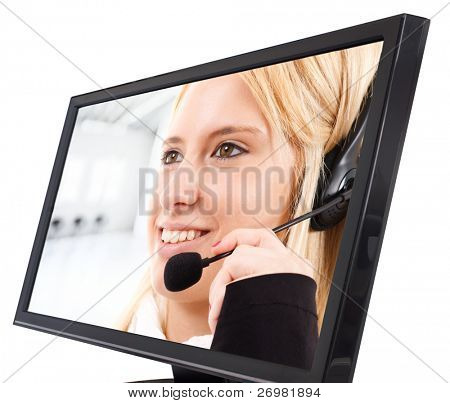 Smiling call center female employee in a computer lcd monitor