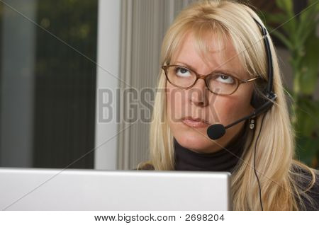 Attractive Businesswoman With Phone Headset