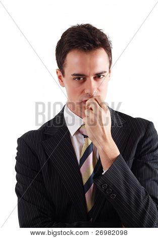 Businessman holding a grudge against someone. Isolated on white.