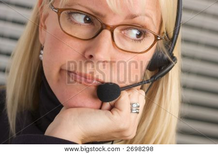 Pensive Businesswoman With Phone Headset