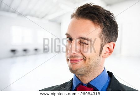 Businessman winking at you