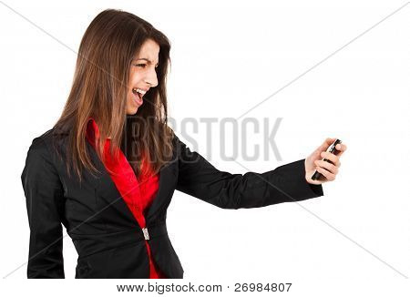 Angry young business woman yelling at her phone isolated over white.