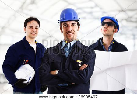 Portrait of three smiling engineers in a contruction site