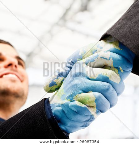 Businessmen shaking world painted hands