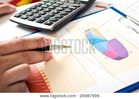 Closeup of businessman's hand doing paperwork