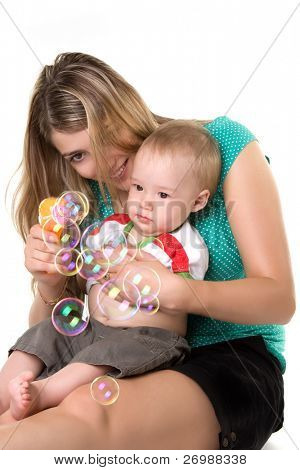 Mother with a child making bubbles