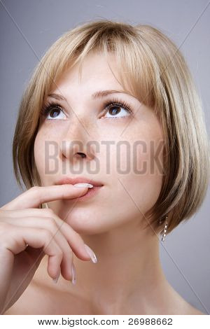 Photo of blonde with brown eyes close up