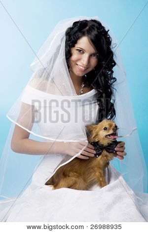 Image about beautiful brunette bride with a dog