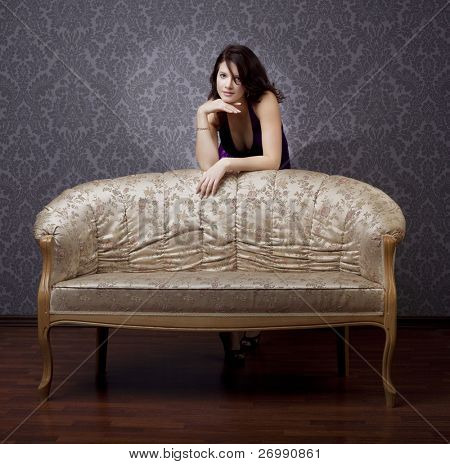 Images of beautiful glamorous girl on the couch