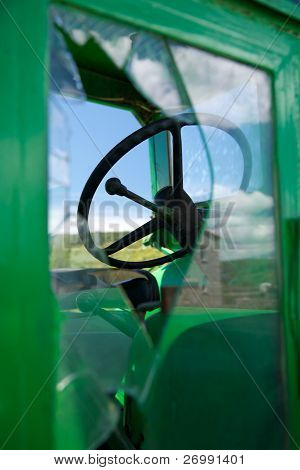 Tractor Wheel Through Broken Window