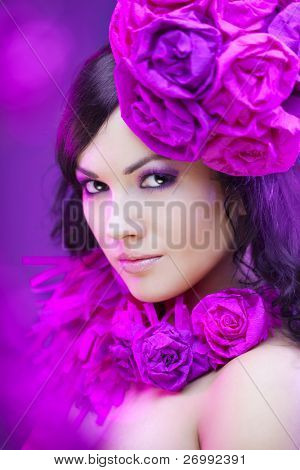 The image of a beautiful girl in a hat with roses
