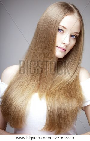 The image of a woman with luxurious hair