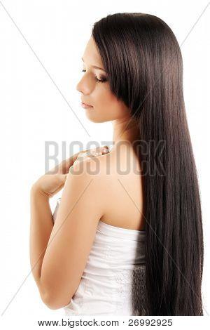 Das Bild einer Frau mit einem luxuriösen, glänzend und schöne Haare