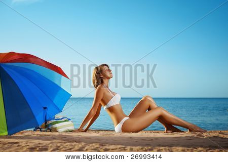 Image of luxury girl lies on the beach