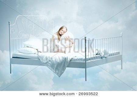 The image of a girl lying on the bed