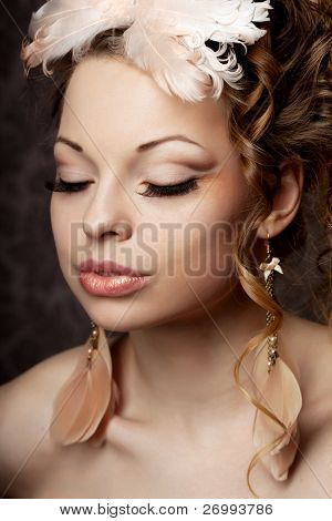 The image of a woman  in a vintage style with luxurious make-up