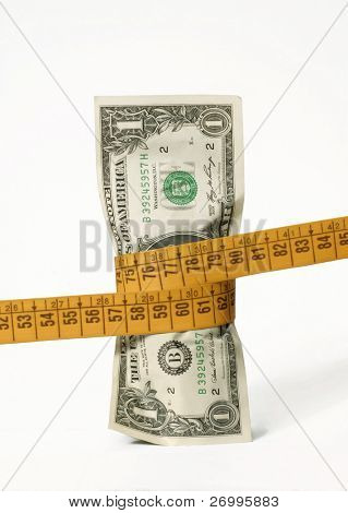 A dollar bill with a tape measure wrapped around it. Dollar bill with tape measure.