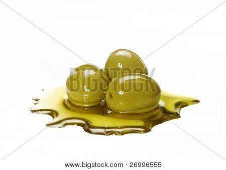 Olive oil and olives. Olive oil on white background.